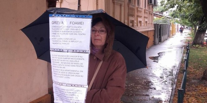 Greva foamei la APIA Teleorman! O femeie stă în ploaie și își cere drepturile refuzate de autoritate